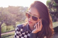 portrait of beautiful woman listening on mobile phone use for people in moder - stock photo
