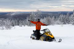 Stock Photo of athlete on a snowmobile
