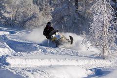 athlete on a snowmobile. - stock photo