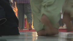 People's feet at the Golden Temple in Amritsar, Punjab, India Stock Footage