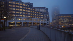 Westferry Circus at Canary Wharf London on a foggy day Stock Footage
