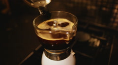 delicious Italian coffee steaming in the mocha cofeepot. - stock footage