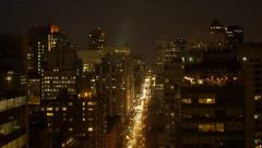 epic aerial view of new york city street and skyscraper buildings at night - stock footage