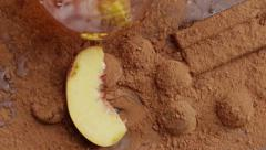 Peach falling  Into cacao slow motion Stock Footage
