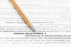 Golden pen on page of sales agreement Stock Photos