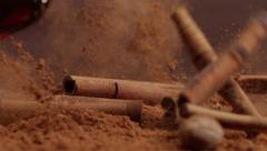 Cinnamon falling Into cacao Stock Footage