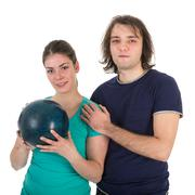cheerful young man and woman with bowling ball - stock photo