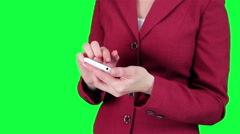 Business woman uses a cell phone chroma key Stock Footage