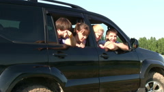 Happy young people in the car - stock footage