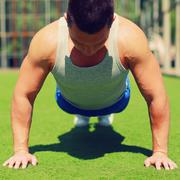 sport, fitness and workout concept - sportsman doing push-ups exercise outdoo - stock photo
