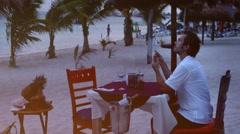 Man in beach restaurant Stock Footage