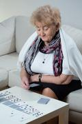 Elder woman playing solitaire Stock Photos
