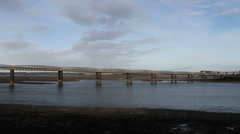 Train crossing bridge Montrose Basin at low tide Scotland Stock Footage