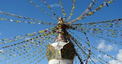 4k buddhist white stupa & flying prayer flags in shangrila yunnan,china. Stock Footage