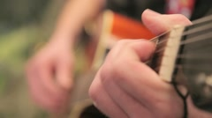 Stock Video Footage of movman playing acoustic guitar relaxing melody on the background of flashing