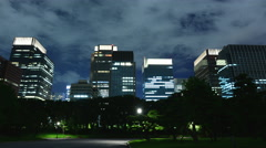 4K -Time Lapse - Tokyo Business District at Night with Clouds - Japan Stock Footage