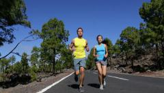 People running exercising jogging on road - Sport runners training Stock Footage