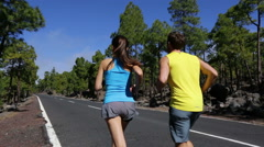 Running sport - runners jogging on mountain road - STEADICAM TRACKING SHOT Stock Footage