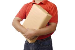 hand deliver a package - stock photo