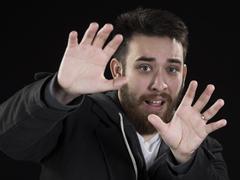 Afraid Young Man with Hands Up Stock Photos