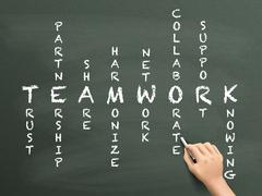teamwork concept crossword written by hand - stock illustration