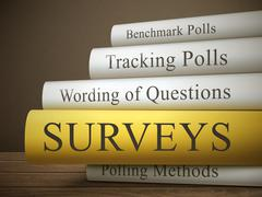 Book title of surveys isolated on a wooden table Stock Illustration