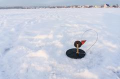 Trap for pike fish on snow in winter - stock photo