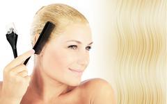 Beautiful blonde female dyeing hair Stock Photos