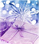 Purple blue christmas gift with baubles decorations Stock Photos