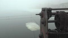 Mechanisms pontoon bridge on the river, winter, HD Stock Footage