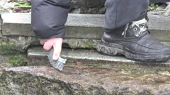 Cleaning ancient steps of the ancient city of algae, HD Stock Footage