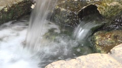 Fresh Spring flows through the rusty pipe HD Stock Footage