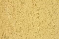 Yellow real plaster texture for your architectural design Stock Photos