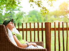 Cute girl resting on veranda Stock Photos