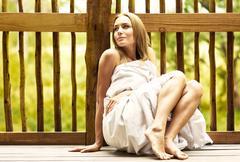 young woman enjoying spa hotel resort - stock photo