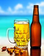 Cold beer on the beach Stock Photos