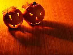 Halloween glowing pumpkins border Stock Photos