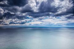 overcast weather over sea - stock photo