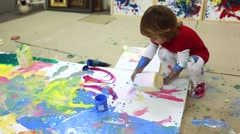 Girl drops a jar full of paint. - stock footage