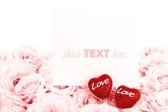 beautiful pink roses with gift card and hearts - stock photo