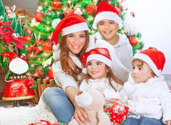 happy family celebrating christmas - stock photo