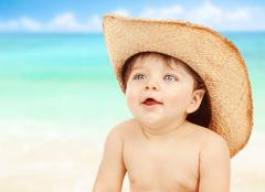 little naked cowboy on the beach - stock photo