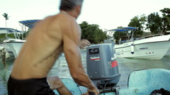 Man starting a motor of boat with several attempts Stock Footage