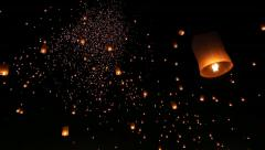 Many Sky Fire Lanterns Floating Of Thailand (long shot) Stock Footage
