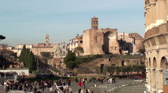 Crowd of tourists at the Roman Forum near the Colosseum Stock Footage