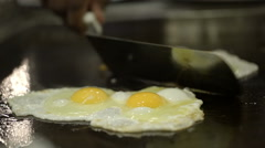 Two portions of fried eggs cooked on the stove Stock Footage