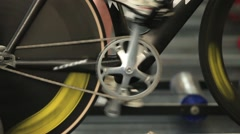 Man to twist pedal stationary bike Stock Footage