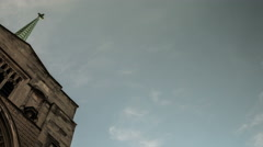 Time lapse looking up at clouds passing swiftly over a church Stock Footage