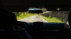 Driving a car on rural road with many green trees around Stock Footage