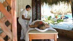 Woman getting professional massage on tropical resort Stock Footage